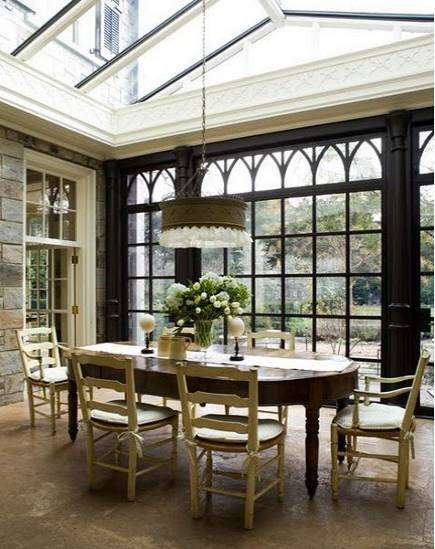 Gothic revival kitchen - arched glass wall in Victorian style conservatory dining room adjacent oto the kitchen - David Duncan Livingston via Atticmag