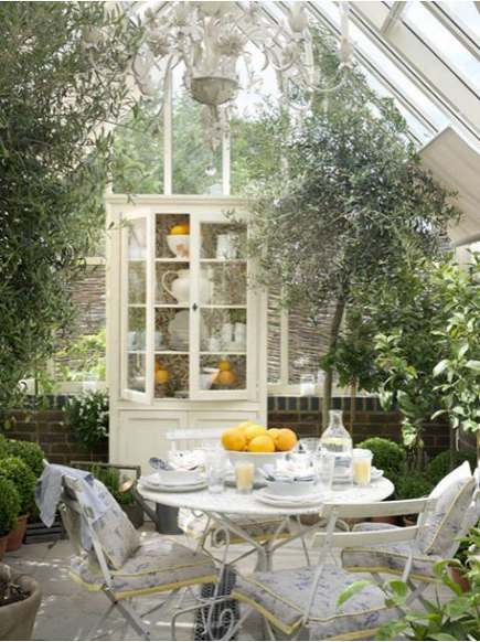 greenhouse rooms - sunroom with brack wall wainscot and floor drain - lucyina via atticmag