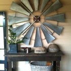 vintage windmill wheel hanging on wall - Absolutely Beautiful Things via Atticmag
