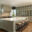 mega storage kitchen cabinets - massive china storage cabinet in a Texas kitchen - vfinehomes via Atticmag