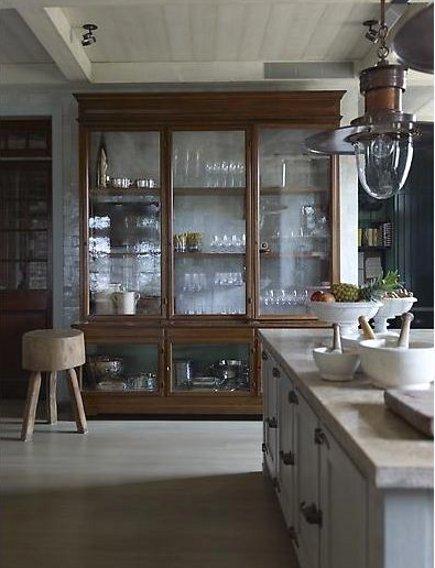mega storage kitchen cabinets - large all glass kitchen storage cabinet set against a tiled wall - SR Gambrel via Atticmag