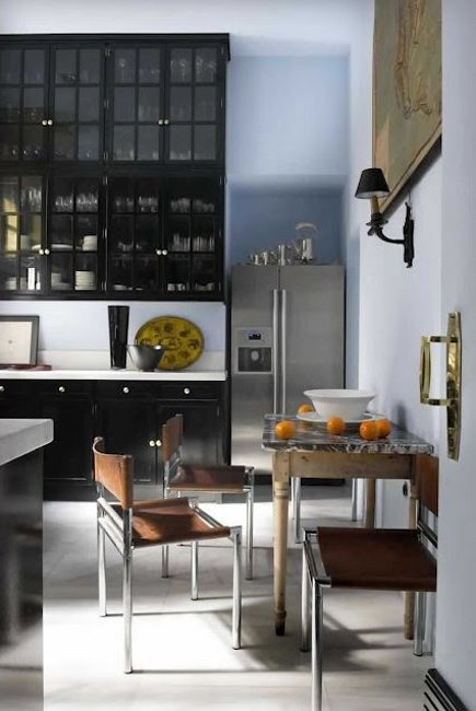 mega storage kitchen cabinets - Spanish kitchen with double stack of upper cabinets, a counter top and cabinets below by Lorenzo Castillo - Habitually Chic via Atticmag
