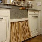 sink drawer - skirted pull out drawer under kitchen sink by Lucianna Samu via Atticmag