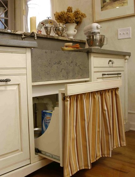 skirted pull out drawer under kitchen sink by Lucianna Samu