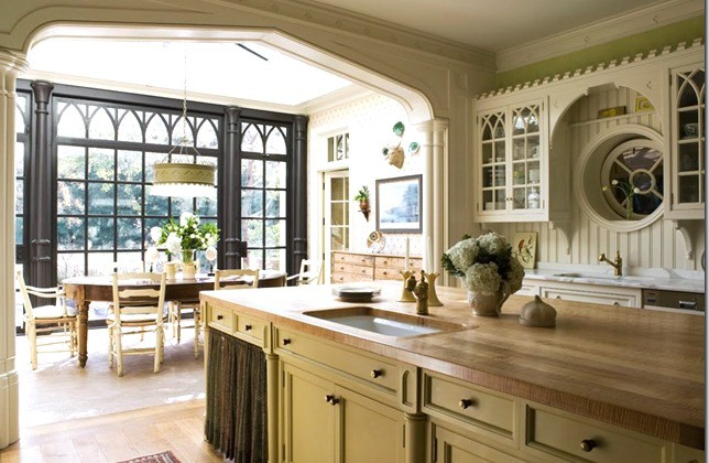 Gothic revival kitchen - white kitchen with exceptional Tudor and Gothic cabinet details - Eric J. Smith via Atticmag