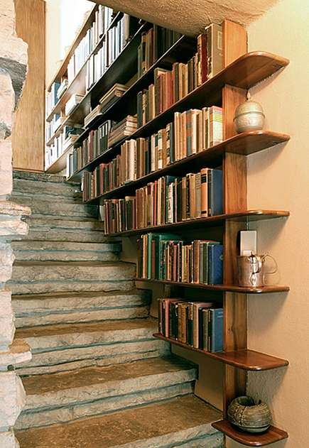 bookcases in the stairway at Fallingwater - tumblr via atticmag