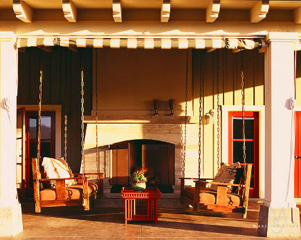 An original Stickley sofa as porch swing with matching copy