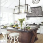 crossbuck kitchens - white kitchen with dark wood crossbuck motif island - house beautiful via atticmag