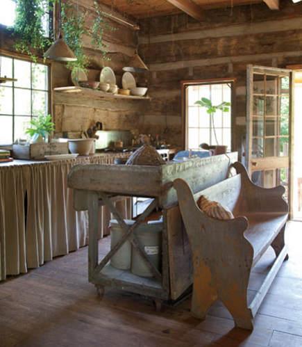 cabin kitchen with crossbuck motif tray-top work table - garden and gun via atticmag