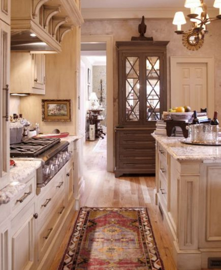 kitchen with crossbuck motifs over mirror on top of a formal hutch - pinterest via atticmag