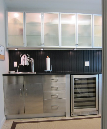 laundry room with black granite counter and matching beadboard backsplash - Atticmag