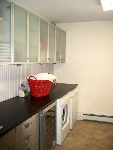 laundry room and mud room with Ikea cabinets before repainting - Atticmag