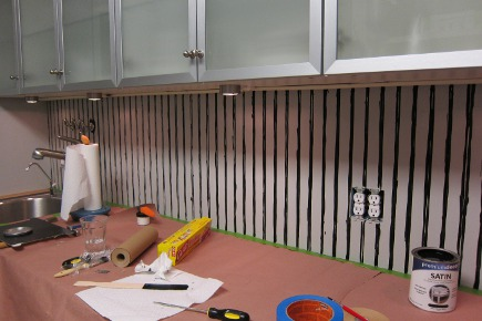 laundry room - painting the grooves in the beadboard - Atticmag