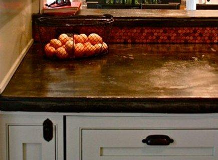 penny mosaic tile - copper penny kitchen backsplash - Alpentile via Atticmag