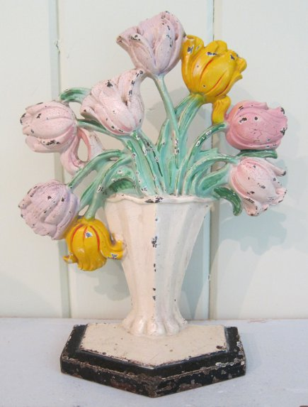 Hubley flower door stops - Hubley number 143 tulip cast iron doorstop - Atticmag