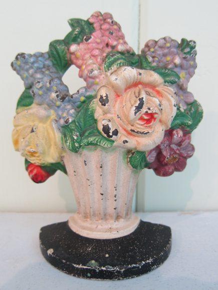 Hubley flower door stops - cast iron mixed flowers doorstop in a black-footed urn, number 479 - Atticmag