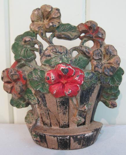 Hubley flower door stops - cast iron nasturtiums doorstop in a striped vase, number 221 - Atticmag