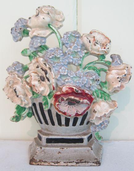 Hubley flower door stops - cast iron anemonies doorstop in a striped urn, number 265 - Atticmag