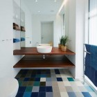 vivid pattern floors - blue color block tile floor in modern bathroom - archdaily via atticmag