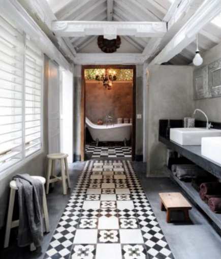 vivid pattern floors - faux-carpet black and white tile runner in a bathroom - mindyourpsandqs, via atticmag