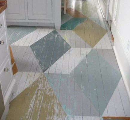 vivid pattern floors - geometric 3-D color block painted wood floor in a cottage style kitchen - pinterest via atticmag