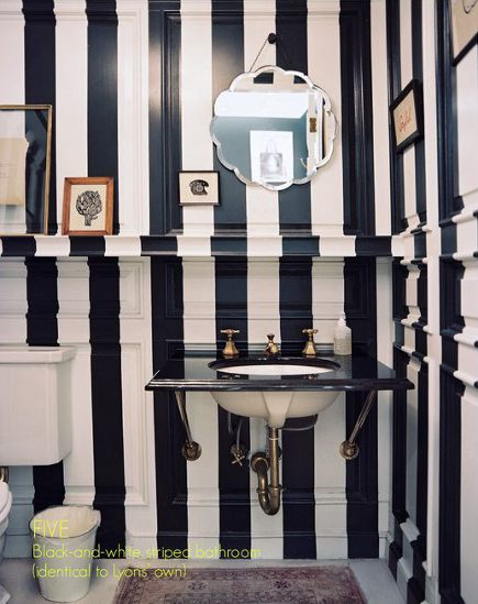 graphic striped walls - bathroom with black and white vertical striped walls - via Atticmag