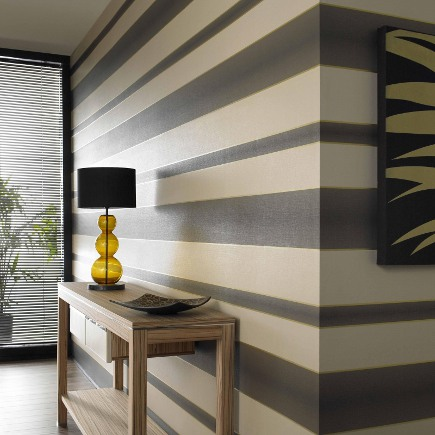 graphic striped walls - brown and gold horizontal striped Verve wallpaper by Graham & Brown via Atticmag