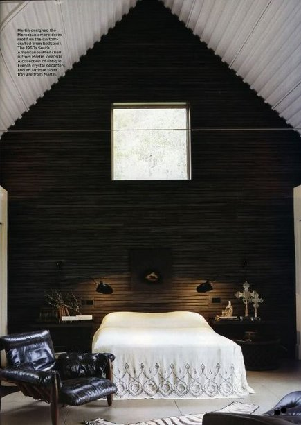 attic bedrooms - dark paneled attic bedroom with white beamed ceiling and high window - Erin Martin Design via Atticmag