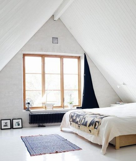 attic bedrooms - utilitarian whitewashed loft bedroom with blackout curtain - even cleveland via atticmag