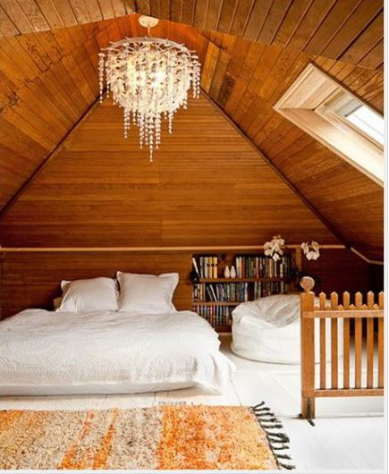 attic bedrooms - wood paneled attic bedroom with important chandelier and dormer window by Jessica Helgerson via Atticmag