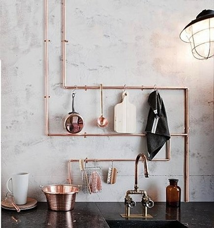 exposed copper plumbing design - copper piping used to create a kitchen tool rack - vtwonen via atticmag