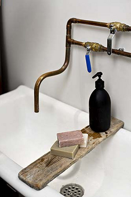 exposed copper plumbing design - primitive exposed copper pipe bathroom sink faucet - French by Design via Atticmag