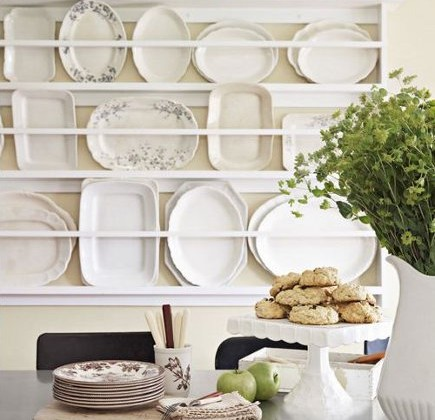 kitchen plate racks - white open-back plate rack on a kitchen wall - country living via atticmag