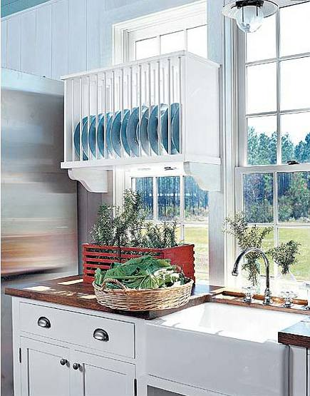 kitchen plate racks - close up of backless plate rack mounted on a kitchen window - Southern Living via Atticmag