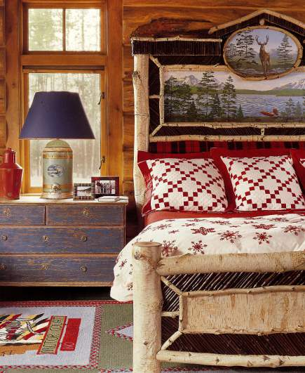 designer log cabin - master bedroom of Idaho timber vacation home with red, green and blue winter theme decor by Anthony Baratta - AD via Atticmag