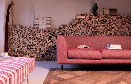 modern living room with firewood stored stacked against wall