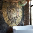halloween home decor - owl and moon painted on brick in a modern loft bathroom - Jean Allsopp Photography via atticmag