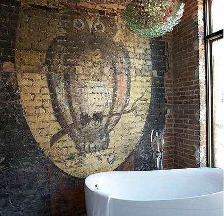 halloween home decor - owl and moon painted on brick in a modern loft bathroom - Jean Allsopp Photography via atticmag