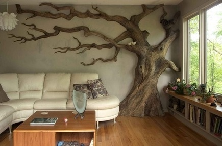 halloween home decor - carved Live Oak tree in living room by Chrysalis Woodworks via atticmag