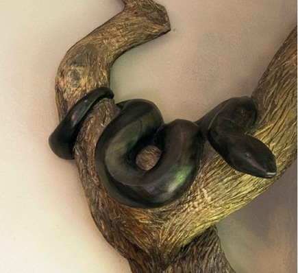 halloween home decor - carved snake in live oak tree carved by Chrysalis Woodworks via atticmag