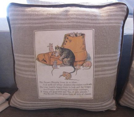 vintage fabric pillows - rag book pillows by Euro-Linens at Patine via Atticmag