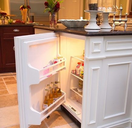 hidden kitchen island features- custom kitchen island with hidden mini fridge - Adorable Decor via Atticmag