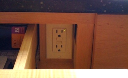 hidden kitchen island features - electrical outlet behind a drawer front - google images via atticmag
