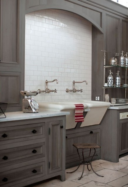 gray kitchens - gray-washed cabinets with double white farm sink - design sponge via atticmag