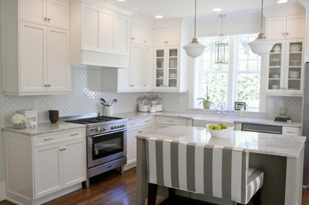gray kitchens - white kitchen with gray and white tent-stripe upholstered double bar bench - Caitlin Greer via Atticmag