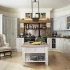 Kit Kemp's kitchen with white limed-oak cabinets and a bottle green Aga cooker - Elle Decor via Atticmag