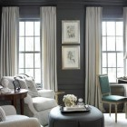 dark gray walls - gray and white sitting room by amy d morris via atticmag