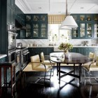 dark green kitchens - kitchen with inky green cabinets and red interiors - AD via Atticmga