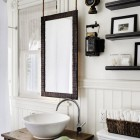suspended mirror in a remodeled Victorian bathroom - Antonio Martins via Atticmag