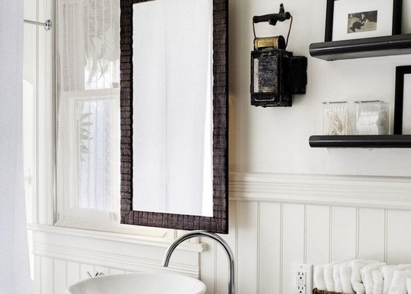 suspended mirror in a remodeled Victorian bathroom - Antonio Martins via Atticmag